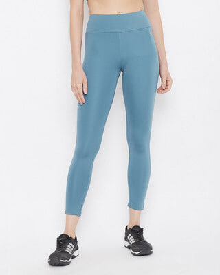 Shop Clovia Snug Fit Active High-Rise Ankle-Length Tights In Light Blue-Front