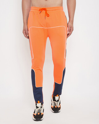 Shop Fugazee Neon Orange Scuba Piping Trackpants-Front
