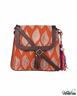 Shop Vivinkaa ethnic faux leather cotton orange beetel with tassle sling bag-Front