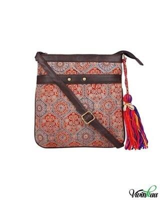 Shop Vivinkaa ethnic faux leather cotton orange nice double stud sling bag-Front