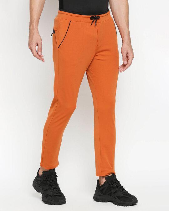 Shop Solid Men Orange Track Pants-Design