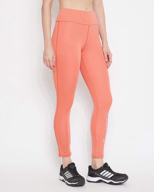 Shop Snug Fit Active Text Print Ankle Length Tights In Coral Orange-Front
