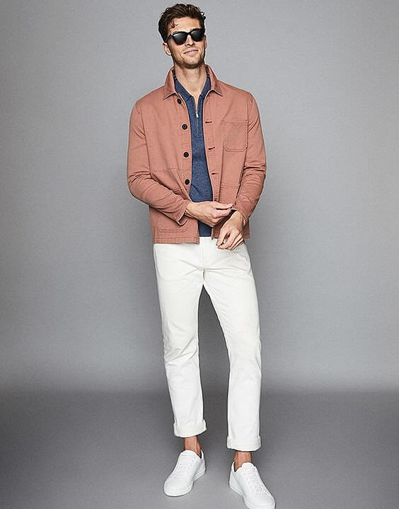 White jeans and orange jacket for men